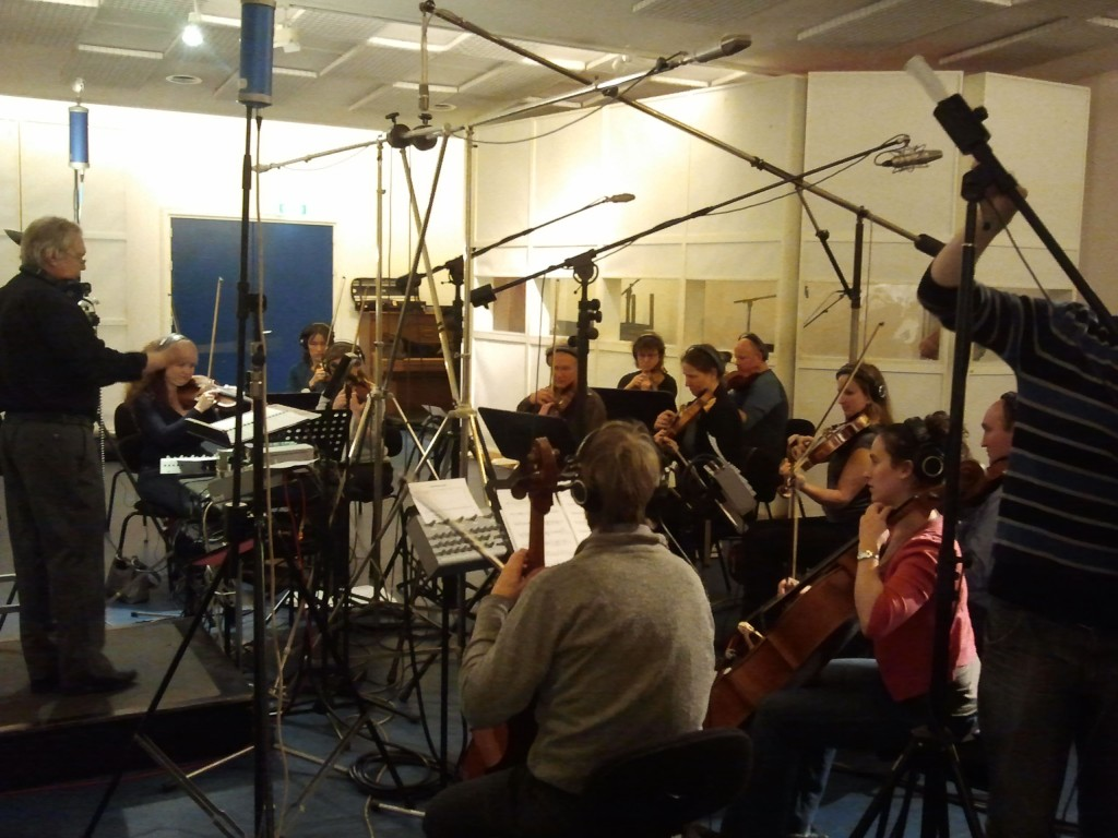 Jan Stulen conducting the orchestra at Power Sound Studio.